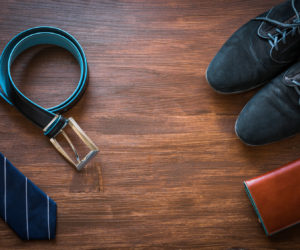 Men fashion accessories. Men wallet, belt, shoes and tie. Still life. Business look.